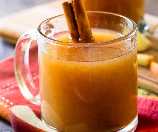 homemade apple cider in a clear mug